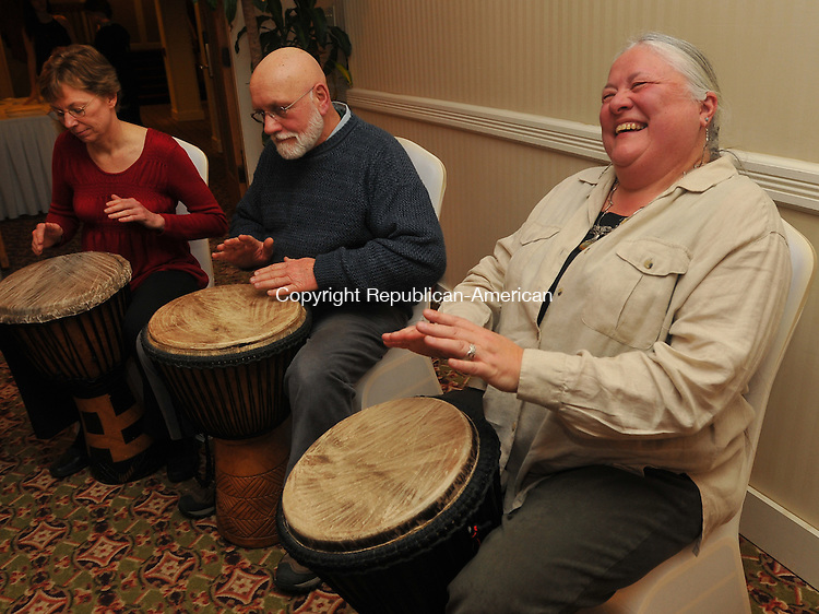 SOUTHBURY, CT- 06 February 2010 - 020610IP09- (from right) Susan and Terry Modzelewski and Anne Taff, members of the Renaissance Center Drummers, entertain guests at the Chocolate Underground show to benefit the programs of the Audubon Center at Bent of the River, at the Heritage Hotel in Southbury on Saturday. The event was co-hosted by New Morning Natural &amp; Organic and The Heritage Hotel. The Audobon Center at Bent of the River is a 700 acre sactuary in Southbury with 15 miles of hiking trails and lots of wildlife.  <br /> Irena Pastorello Republican-American
