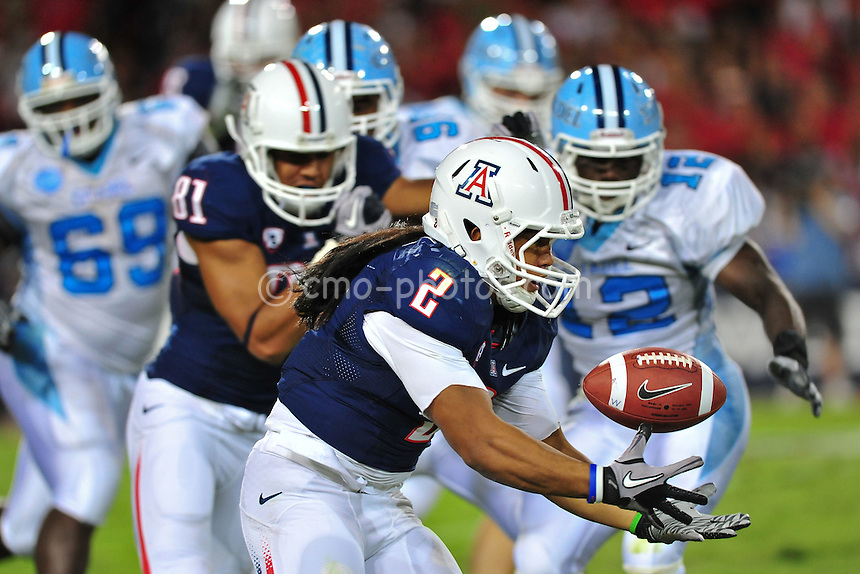 Sept 11, 2010; Tucson, AZ, USA; Arizona Wildcats running back Keola Antolin (2) bobbles the football in the 2nd quarter of a game against the Citadel Bulldogs at Arizona Stadium. Arizona won the game 52-6.