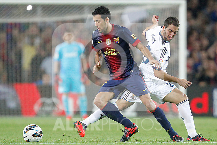 Barcelona's Sergio Busquets and Real Madrid's Gonzalo Higuain during la Liga match on october 7th 2012. ..Photo: Cesar Cebola  / ALFAQUI