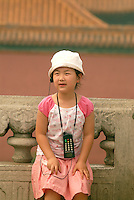 A young girl listens to an audio guide at the Forbidden City in Beijing. The Forbidden City was the Chinese imperial palace from the Ming Dynasty to the end of the Qing Dynasty, and off limits to most Chinese for 500 years. .