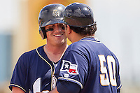 San Antonio Missions designated hitter Hunter Renfroe (10) laughs as he talks to Manager Rod Barajas (50) during the Texas League baseball game against the Midland RockHounds on June 28, 2015 at Nelson Wolff Stadium in San Antonio, Texas. The Missions defeated the RockHounds 7-2. (Andrew Woolley/Four Seam Images)