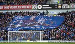 The Jock Wallace Battle Fever banner passed along the Broomloan Road stand