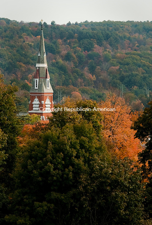 TORRINGTON, CT--- -102115JS11---The steeple of St Francis of Assisi Church in Torrington is seen surrounded by fall foliage on Wednesday. Mild temperatures are expected to continue through the end of the week. <br /> Jim Shannon Republican-American