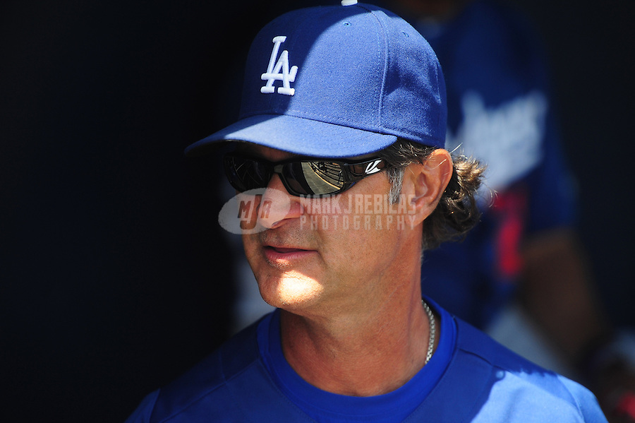 Mar. 27, 2012; Peoria, AZ, USA; Los Angeles Dodgers manager Don Mattingly in the first inning against the San Diego Padres at Peoria Stadium.  Mandatory Credit: Mark J. Rebilas-
