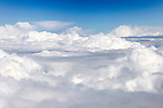 Stock photo of White clouds over blue sky aerial view from a plane flying above clouds Horizontal background