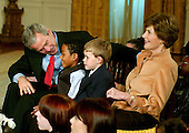 "Washington, D.C. - December 4, 2006 -- United States President George W. Bush and first lady Laura Bush participate in Children's Holiday Reception and Performance of ""Willy Wonka and the Chocolate Factory"" in the East Room of The White House in Washington, D.C. on Monday, December 4, 2006. .Credit: Ron Sachs / CNP"