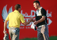 Lee Westwood (ENG) and Martin Kaymer (GER) finish their match on the 18th green during Thursday's Round 1 of the HSBC Golf Championship at the Abu Dhabi Golf Club, United Arab Emirates, 26th January 2012 (Photo Eoin Clarke/www.golffile.ie)