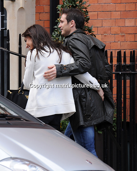 EXCLUSIVE PICTURE: MATRIXPICTURES.CO.UK.PLEASE CREDIT ALL USES..WORLD RIGHTS..British television personality Christine Bleakely and her boyfriend, English professional footballer Frank Lampard, are spotted out in Knightsbridge, London...The Dancing On Ice star is seen jumping out of the Range Rover to help direct the Chelsea midfielder as he struggles to park the car...APRIL 26th 2013..REF: MTX 132807