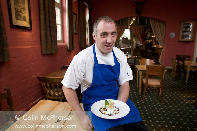 Chef Dan Whitmore with a starter dish of grilled Kidderton Ash goats cheese, served at the Cholmondeley Arms in the village of the same name in Cheshire, pictured as part of the Cheshire Food Trail. The building was formerly a school house and has been an award-winning pub and restaurant since it's conversion 20 years ago.