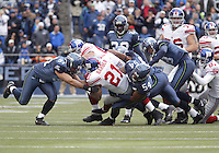 27 Nov 2005:  Seattle Seahawks linebackers #51 Lofa Tatupu and #54 D.D. Lewis wrap up New York Giants running back Tiki Barber at Qwest Field in Seattle, Washington.