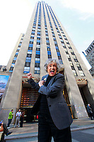 "Gloria Clyne poses in front of 30 Rockefeller Plaza wearing a contemporary NBC page jacket, New York, NY on March 18, 2010.  Clyne, 83, worked 55 years for NBC, starting out as one of the network's first female pages in 1944 and working her way up from page to ""floor wash girl"" to ""script girl"" and finally to production assistant as TV replaced radio inside NBC.."