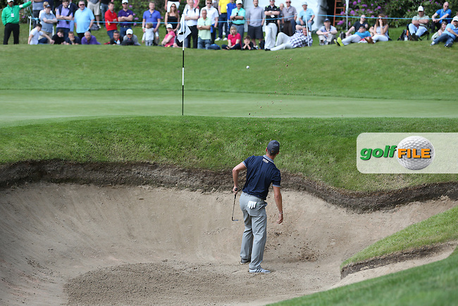 Martin Kaymer (GER) gets out of the bunker on the 3rd during Round Three of the 2015 BMW PGA Championship over the West Course at Wentworth, Virginia Water, London. 23/05/2015. Picture David Lloyd | www.golffile.ie.