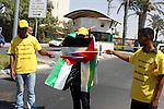 Members of the Palestinian Popular Committee for Boycotting Settlement Products protest outside an Israeli Shopping Center on the northern outskirts of the West Bank city of Ramallah, near the Adam settlement, to call for implementing a decision to boycott Israeli settlement-made goods in the Palestinian territories on September 23, 2010. The protesters held up placards against dealing with Rami Levy supermarkets -- a chain of stores that operates in settlements in the occupied West Bank named after its millionaire Israeli owner Photo by Eyad Jadallah