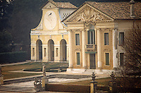 A paved terrace lined with statuary leads to the imposing entrance of the Villa di Maser one of Palladio's finest architectural achievements