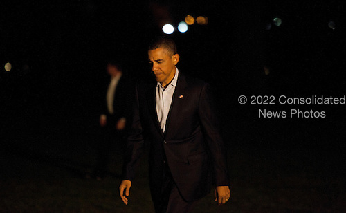 United States President Barack Obama walks toward the White House in Washington, D.C. after returning from his trip to the Middle East on March 23, 2013. He visited Israel, the Palestinian National Authority and Jordan. .Credit: Aude Guerrucci / Pool via CNP