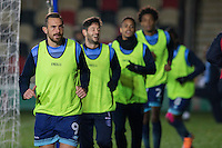Paul Hayes of Wycombe Wanderers leads a warm up jog ahead of the Sky Bet League 2 match between Newport County and Wycombe Wanderers at Rodney Parade, Newport, Wales on 22 November 2016. Photo by Mark  Hawkins.