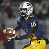 Kenny Galvin #10 of Massapequa takes a snap during the Nassau County Conference I varsity football semifinals against Freeport at Hofstra University on Saturday, Nov. 11, 2017.