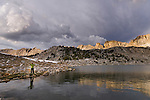 Sunset fly fishing at Steelhead Lake with storm clouds in the High Sierra mountains near Pine Creek Pass and French Canyon.