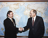 United States Secretary of Defense Dick Cheney hosted an Honor Arrival Cordon at the River Entrance of the Pentagon in Washington, DC on February 22, 1991 for Foreign Minister Kurtcebe Alptemocin of Turkey.  Here they meet in the Seretary's office for a brief photo session.<br /> Mandatory Credit: Helene C. Stikkel / Dod via CNP