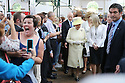 A woman trys to do a selfie while Britain's Queen Elizabeth II tours St.Georges Market in Belfast, Tuesday June 24th, 2014. The Queen is on a 3 day tour of Northern Ireland. Photo/Paul McErlane