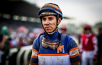 ARCADIA, CA - DECEMBER 26: Jockey Giovanni Franco walks back to the jocks room after a race at Santa Anita Park on December 26, 2017 in Arcadia, California. (Photo by Alex Evers/Eclipse Sportswire/Getty Images)