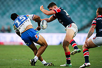 Ligi Sao loses the ball in a big tackle. Sydney Roosters v Vodafone Warriors, NRL Rugby League. Allianz Stadium, Sydney, Australia. 31st March 2018. Copyright Photo: David Neilson / www.photosport.nz
