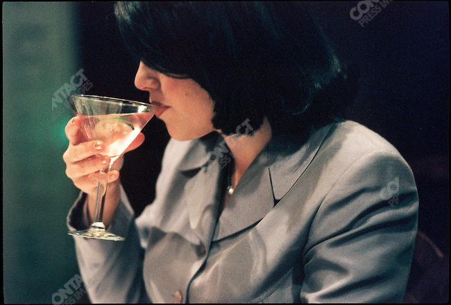 After two weeks of being hounded by the press and shadowed by the FBI, Monica Lewinsky, the former White House intern, is photographed sipping a Cosmopolitan martini at Morton's Bar. Washington DC, USA, February 21, 1998
