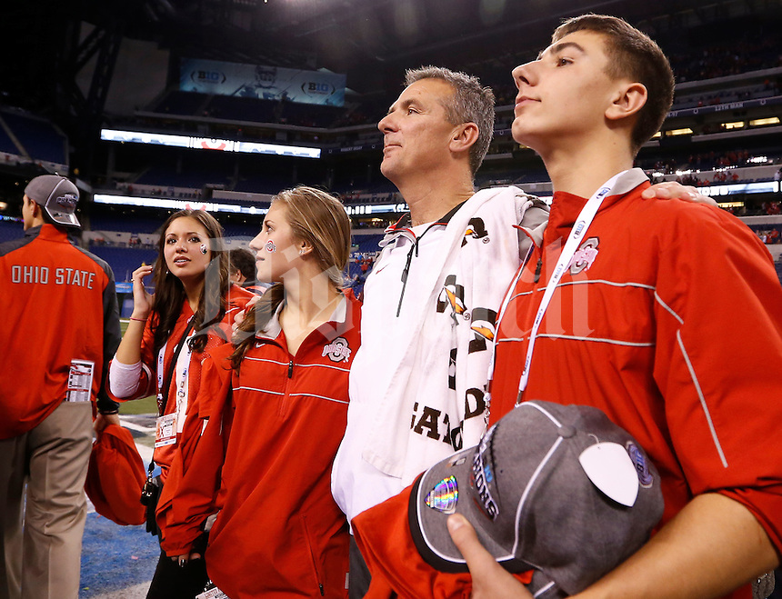 Ohio State Buckeyes head coach Urban Meyer stands with his kids, from left, Nikki, Gigi and Nate following the 59-0 win over Wisconsin in the Big Ten Championship game at Lucas Oil Stadium in Indianapolis on Dec. 6, 2014. (Adam Cairns / The Columbus Dispatch)