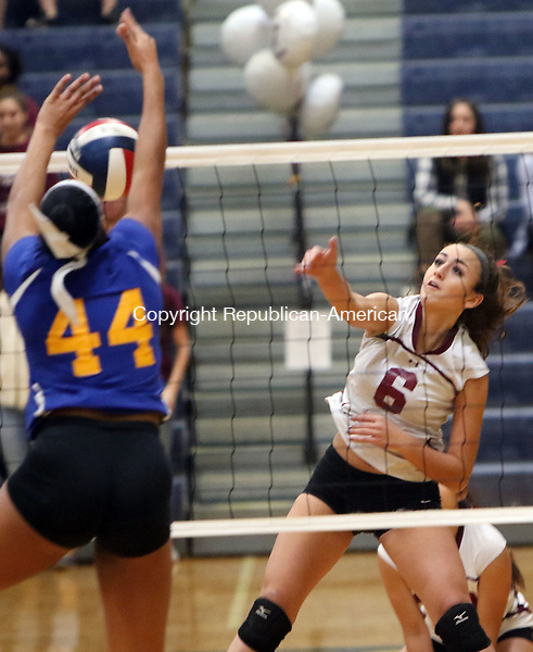 EAST HAVEN CT. 19 November 2016-111916SV15-#6 Carissa Carbone of Torrington High hits a shot over the net as #44 Faith Thurmond of Seymour High defends during the CIAC Class M Volleyball championship game at East Haven High in East Haven Saturday. Seymour won 3-0.<br /> Steven Valenti Republican-American