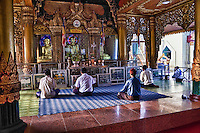 Myanmar, Burma, Yangon.  Sule Pagoda, Early Morning Worshipers.