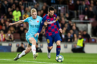 5th November 2019; Camp Nou, Barcelona, Catalonia, Spain; UEFA Champions League Football, Barcelona versus Slavia Prague; Lionel Messi holds off a challenge during round 4 of UEFA Champions League match against Slavia Praga - Editorial Use