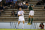 24 September 2013: William and Mary's Chris Dunn (8) heads the ball over North Carolina's Marco Sunol (26). The University of North Carolina Tar Heels hosted the College of William and Mary Tribe at Fetzer Field in Chapel Hill, NC in a 2013 NCAA Division I Men's Soccer match. William and Mary won the game 1-0.