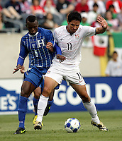 Brian Ching (11) battles for the ball with Erick Norales (5).  The US Men's National Team defeated Honduras 2-0 in the semifinals of the Gold Cup at Soldier Field in Chicago, IL on July 23, 2009.