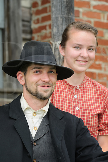 Couple from the 1880's American Wild West, a man and woman in their twenties in reenactor portrayal.