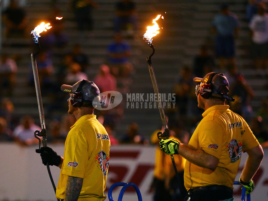 May 30, 2014; Englishtown, NJ, USA; NHRA safety safari starting line crew members hold blow torches during qualifying for the Summernationals at Raceway Park. Mandatory Credit: Mark J. Rebilas-