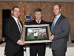 Chairperson Pio Smith and Hon Secretary Danny Nugent present a photo of Charlie McAllister to Chairperson of the Louth County Board Des Halpenny at the Newtown Blues awards night in the Westcourt Hotel.  Photo:Colin Bell/pressphotos.ie