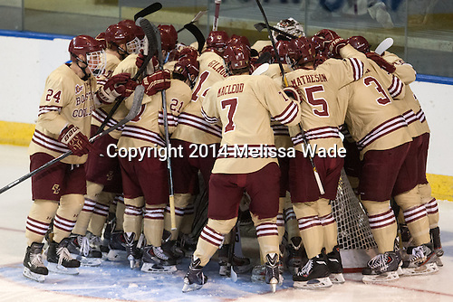 The Eagles gather around their net. - The Boston College Eagles defeated the University of Massachusetts Lowell River Hawks 4-3 in the NCAA Northeast Regional final on Sunday, March 30, 2014, at the DCU Center in Worcester, Massachusetts.
