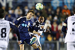 20 March 2013: Carolina's Zack Schilawski (in blue) heads the ball away from UNAM's Fernando Espinosa (MEX) (right). The NASL Carolina RailHawks played LigaMX's Pumas de la UNAM at WakeMed Stadium in Cary, North Carolina in an international club friendly soccer game.