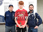 Ardee Celtic's U-15 player of the year Finn Kelly with coaches Conor Lynch and Aidan Woods. Photo:Colin Bell/pressphotos.ie