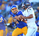 BROOKINGS, SD - SEPTEMBER 26:  JR Plote #91 from South Dakota State chases down quarterback Mathew Barr #2 from Robert Morris in the first quarter Saturday evening at Coughlin Alumni Stadium.  (Photo by Dave Eggen/Inertia)