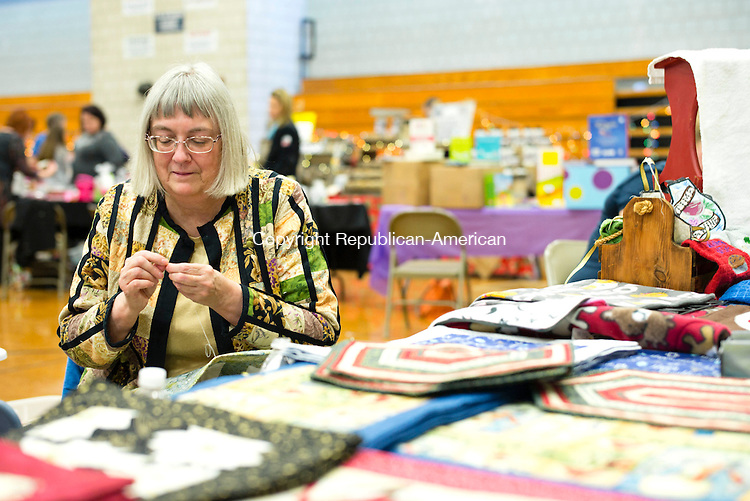 Woodbury, CT- 19 November 2016-111916CM04-  Linda Stein co-owner of Unique Sisters Workshop works on a quilt during a bazaar at Woodbury Middle School on Saturday.  The event was put on by the Nonnewaug High School Grad Nite committee and featured 50 vendors selling various crafts and goods. Proceeds from the fair will  benefit Graduation Night festivities.  Christopher Massa Republican-American