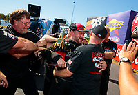 Oct 14, 2019; Concord, NC, USA; NHRA top alcohol funny car driver Sean Bellemeur celebrates with crew after clinching the 2019 championship during the Carolina Nationals at zMax Dragway. Mandatory Credit: Mark J. Rebilas-USA TODAY Sports