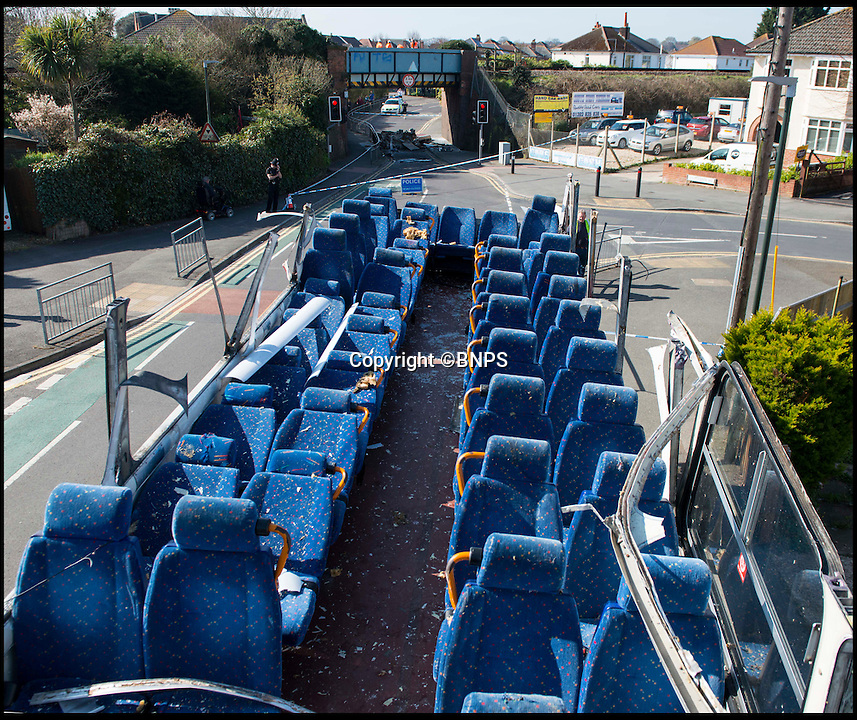 BNPS.co.uk (01202 558833)<br /> Pic: TomWren/BNPS<br /> <br /> The top deck of the bus.<br /> <br /> Students had a miraculous escape today after the roof of a double decker bus sheared off when it ploughed into a railway bridge next to a primary school.<br /> <br /> Teenagers on the top deck ducked at the moment the vehicle crashed, ripping off the headrests of their seats and slicing off the roof.<br /> <br /> The dramatic collision occurred just as hundreds of young children arrived at the primary school in Bournemouth with many lucky not to have been hit by the roof as it fell onto the road or by debris.