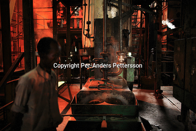 LUKUTU, DEMOCRATIC REPUBLIC OF CONGO MARCH 17: An unidentified man works in a palm oil factory on March 17, 2006 in Lukutu, Congo, DRC. Lukutu is a small village along the Congo River, about 1500 kilometers from Kinshasa, the capital. The factory is a big producer of palm oil, which is mainly used for cooking. The Belgians built the factory in 1911 and it was closed during the recent civil war. About 10,000 people are dependent on the factory, the only one in the area. Congo River is a lifeline for millions of people, who depend on it for transport and trade. During the Mobuto era, big boats run by the state company ONATRA dominated the traffic on the river. These boats had cabins and restaurants etc. All the boats are now private and are mainly barges that transport goods. The crews sell tickets to passengers who travel in very bad conditions, mixing passengers with animals, goods and only about two toilets for five hundred passengers. The conditions on the boats often resemble conditions in a refugee camp. Congo is planning to hold general elections by July 2006, the first democratic elections in forty years..(Photo by Per-Anders Pettersson/Getty Images)...