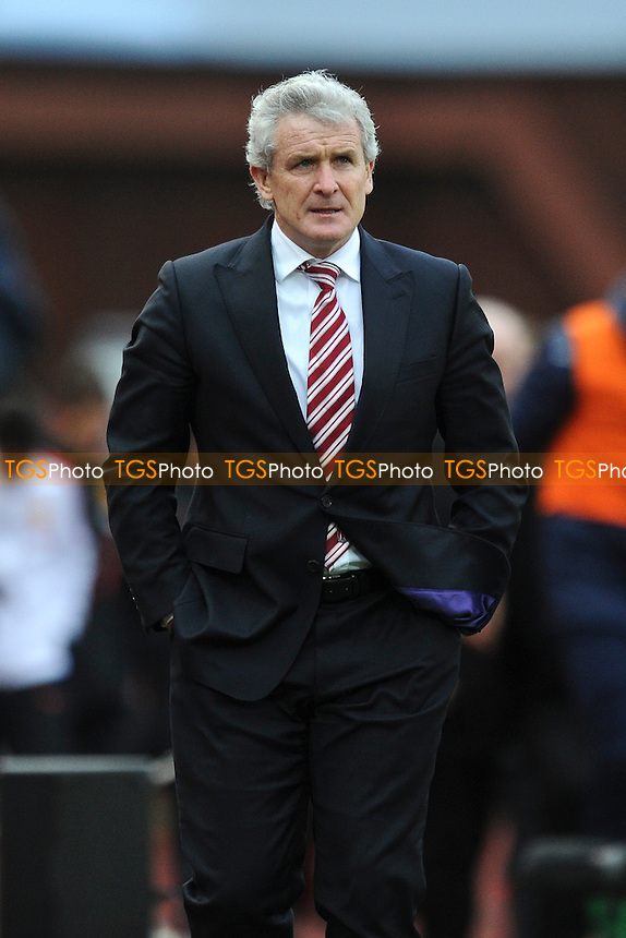 Stoke City manager Mark Hughes - Stoke City vs Manchester United - Barclays Premier League Football at the Britannia Stadium, Stoke-on-Trent - 01/01/15 - MANDATORY CREDIT: Greig Bertram/TGSPHOTO - Self billing applies where appropriate - contact@tgsphoto.co.uk - NO UNPAID USE