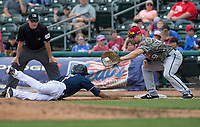 NWA Democrat-Gazette/BEN GOFF @NWABENGOFF<br /> Nicky Lopez, Northwest Arkansas shortstop, dives back safe at first ahead of a pickoff throw to Arkansas first baseman Dario Pizzano in the 4th inning Wednesday, May 16, 2018, at Arvest Ballpark in Springdale.