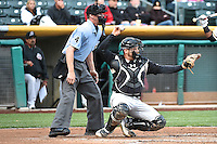 Home plate umpire Scott Mahoney (4) and Stephen Vogt (26) of the Sacramento River Cats in action against the Salt Lake Bees at Smith's Ballpark on April 3, 2014 in Salt Lake City, Utah.  (Stephen Smith/Four Seam Images)