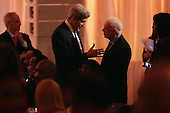 United States Secretary of State John Kerry (L) talks with former President Jimmy Carter during a dinner on the occassion of the U.S.-Africa Leaders Summit on the South Lawn of the White House August 5, 2014 in Washington, DC. President Barack Obama is promoting business relationships between the United States and African countries during the three-day U.S.-Africa Leaders Summit, where 49 heads of state are meeting in Washington. <br /> Credit: Chip Somodevilla / Pool via CNP