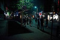 Evening landscape view of people waiting at a bus stop on Shi Li Da Dao in the Lúshān Qū of Jiǔjiāng in Jiangxi Province.  © LAN