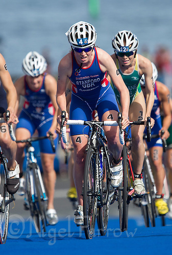 24 AUG 2013 - STOCKHOLM, SWE - Non Stanford (GBR) (centre, in blue, red and white) of Great Britain climbs a hill during the bike at the elite women's ITU 2013 World Triathlon Series round in Gamla Stan in Stockholm, Sweden (PHOTO COPYRIGHT © 2013 NIGEL FARROW, ALL RIGHTS RESERVED)